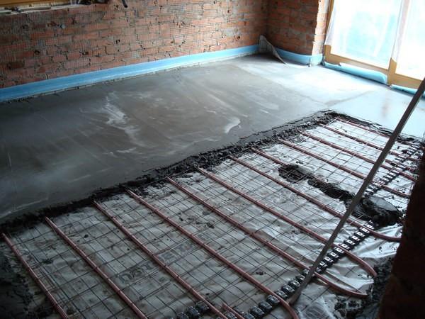 Монтаж теплых полов в бетонной стяжке: инструкция по монтажу3