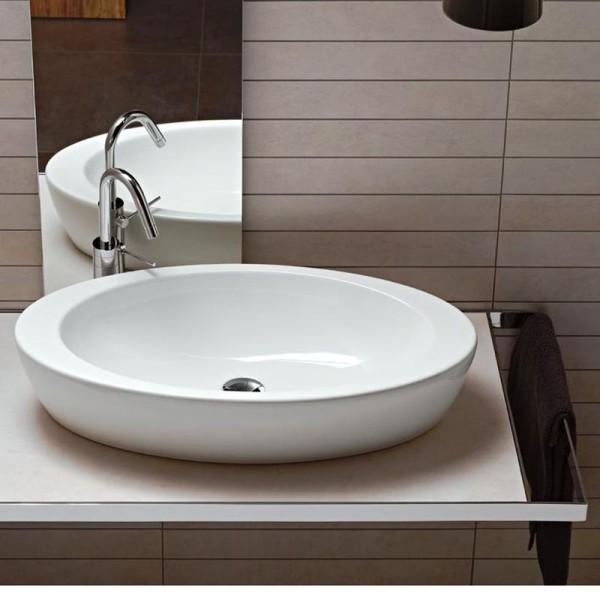 Накладная каменная раковина – атрибут эксклюзивной ванной комнаты5